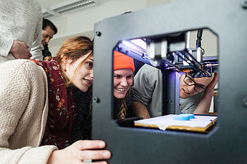 Students at a 3D printer