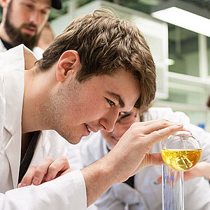 Student pouring liquid into a test tube