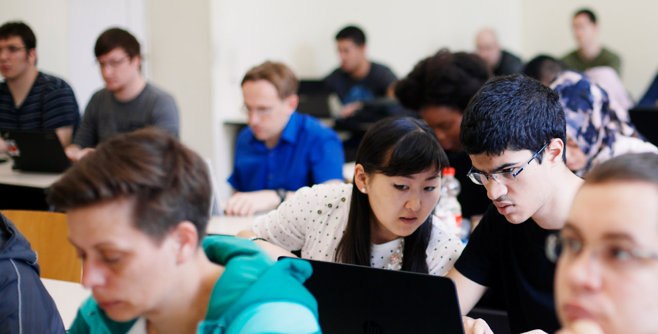 Two international students attending a course