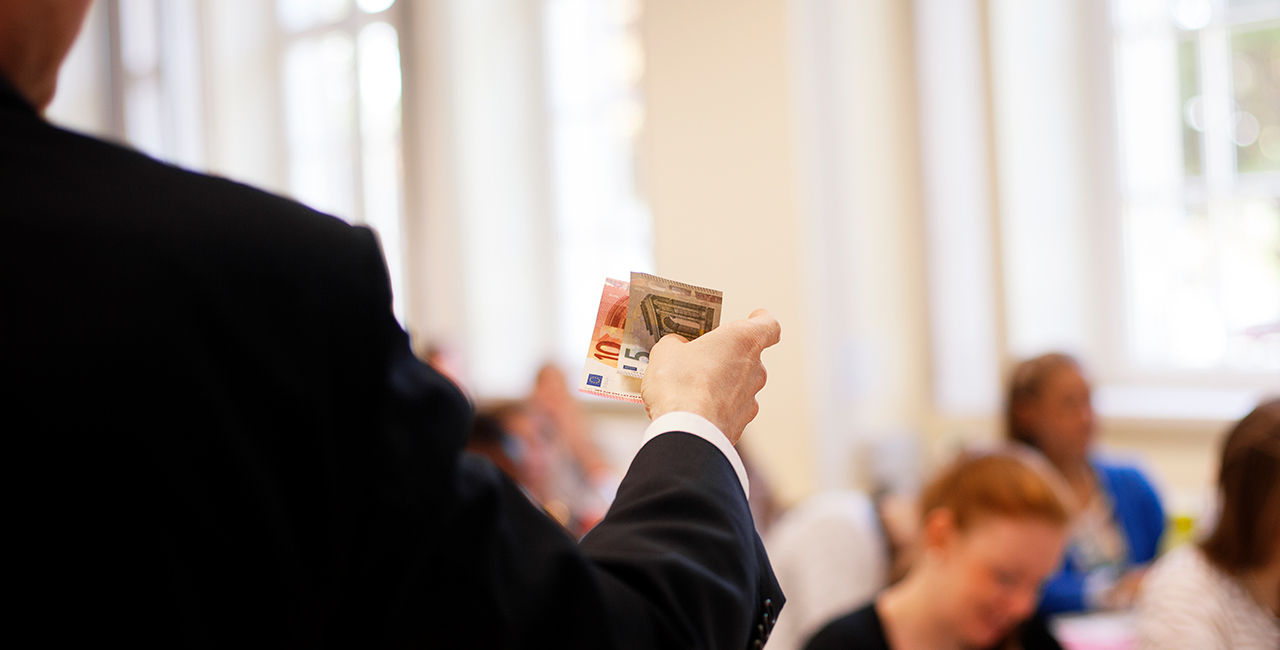 Professor holding banknotes in his hand