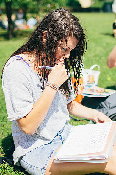 Reading student on the grass